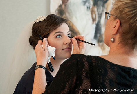 Faye applying eyeliner to bride